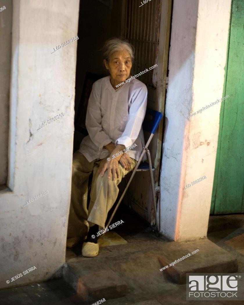 Stock Photo: Old woman in Hanoi. Vietnam.