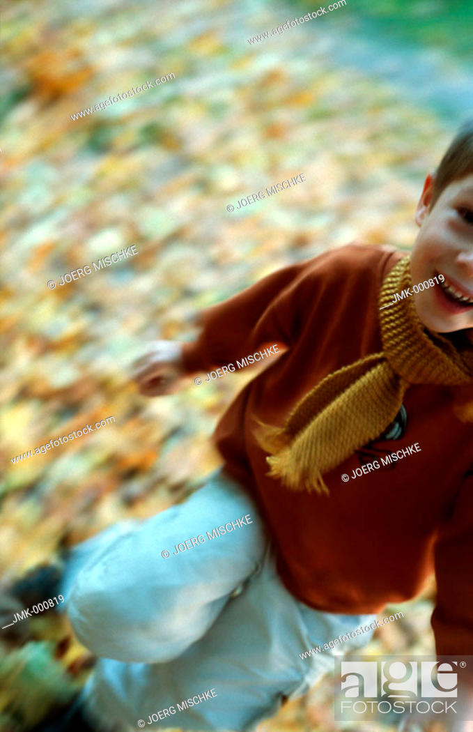 Stock Photo: Little boy in the autumnal wood, forest, running.
