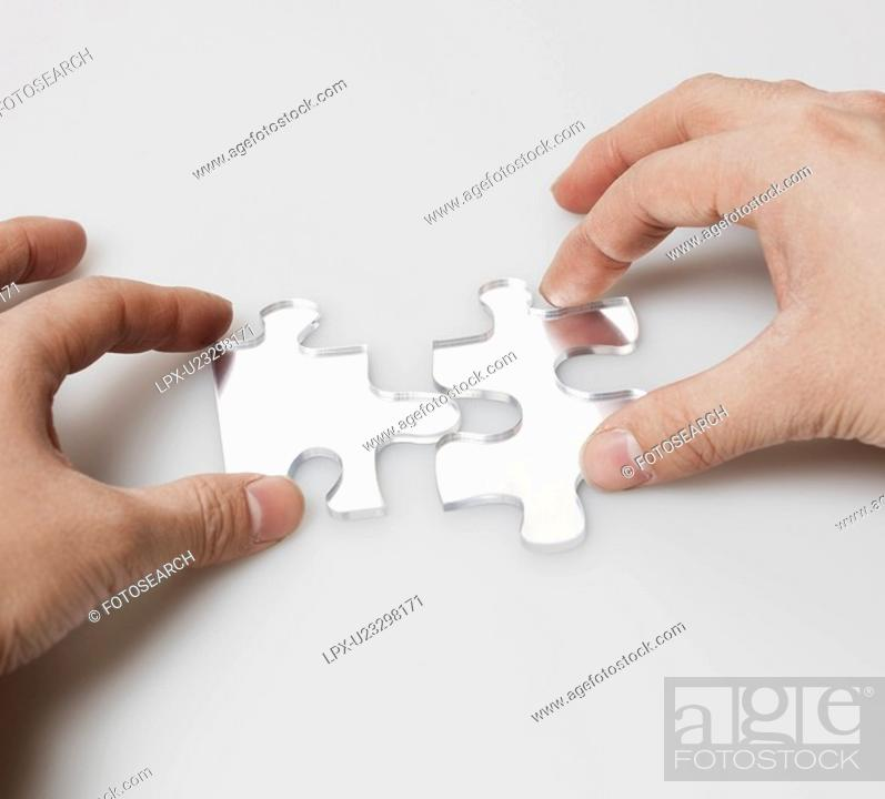 Stock Photo: Person Doing Jigsaw Puzzle.