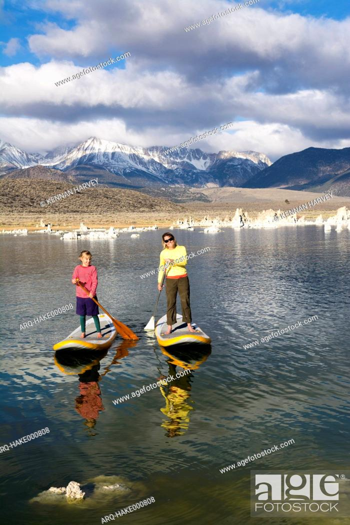 Stock Photo: A woman and her daughter stand up paddleboarding on Mono Lake from South Tufa Beach, Lee Vining, California.