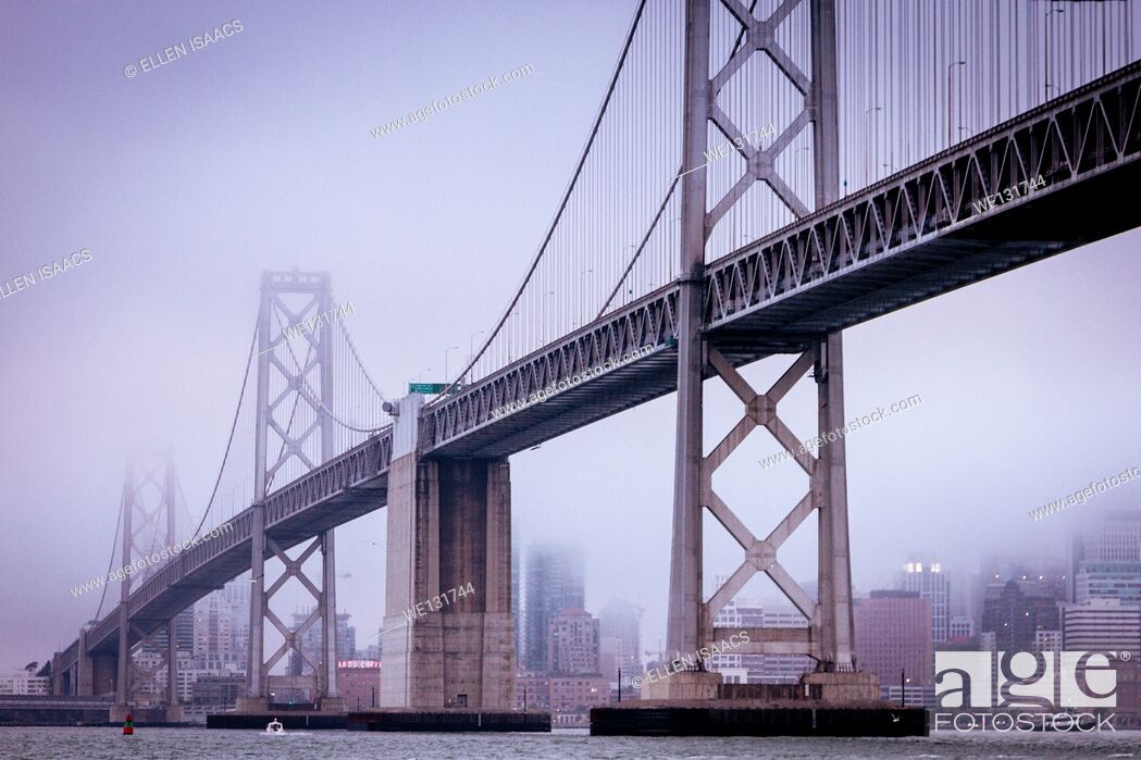 Stock Photo: San Francisco Bay Bridge and the city from the water on a cold and foggy day.