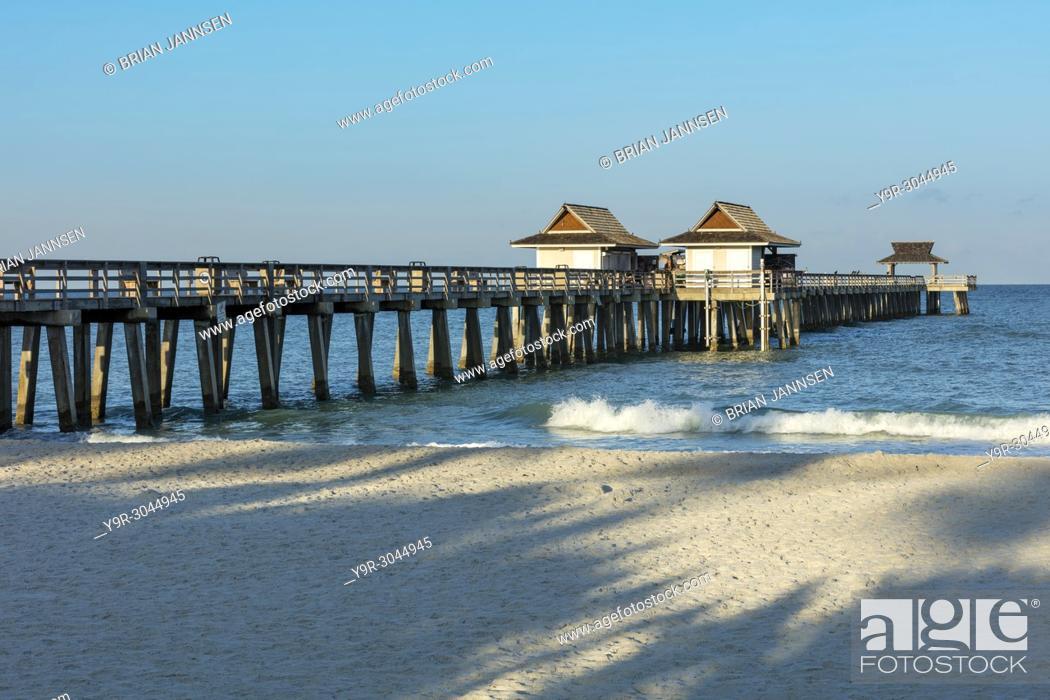 Stock Photo: Early morning at the Naples Pier along Florida's Gulf Coast, Naples, Florida, USA.