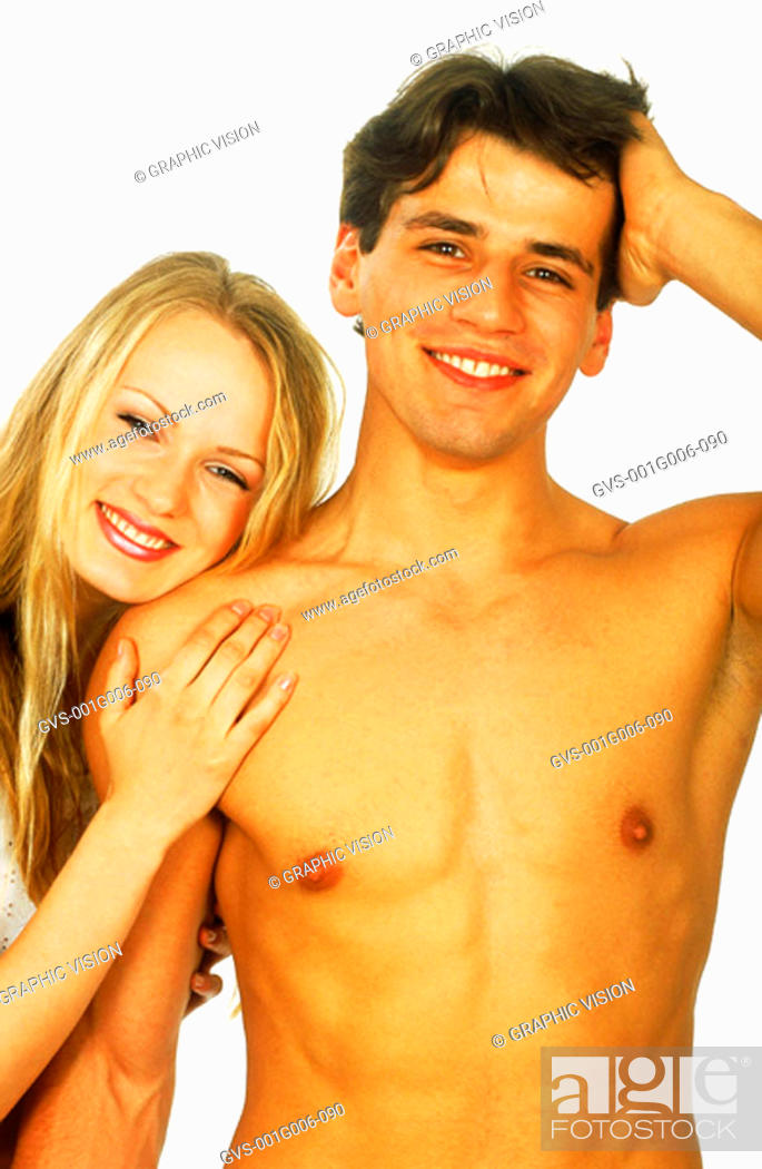 Stock Photo: Portrait of young couple smiling.