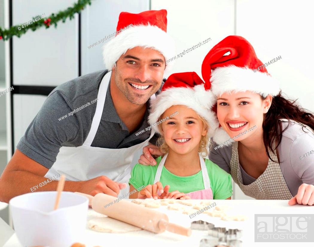 Stock Photo: Happy family preparing Christmas cookies in the kitchen.