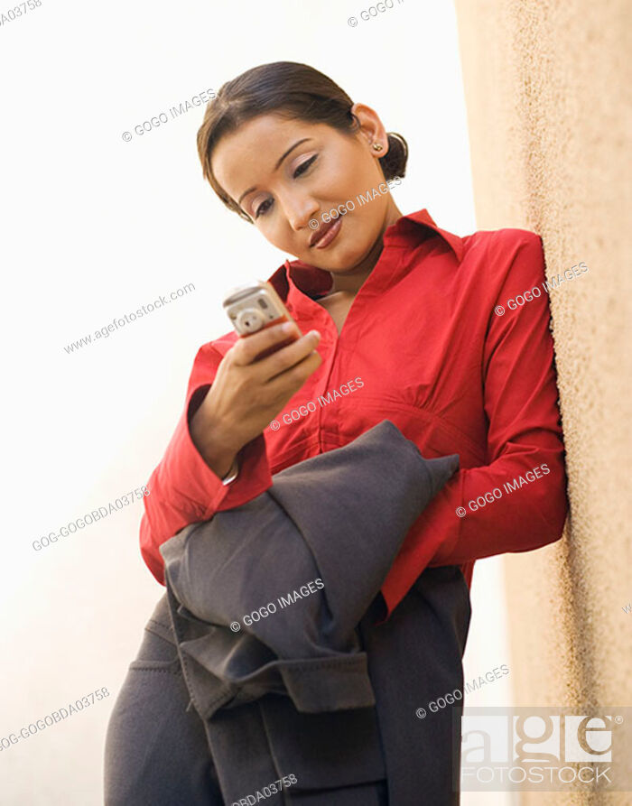 Stock Photo: Businesswoman text messaging.