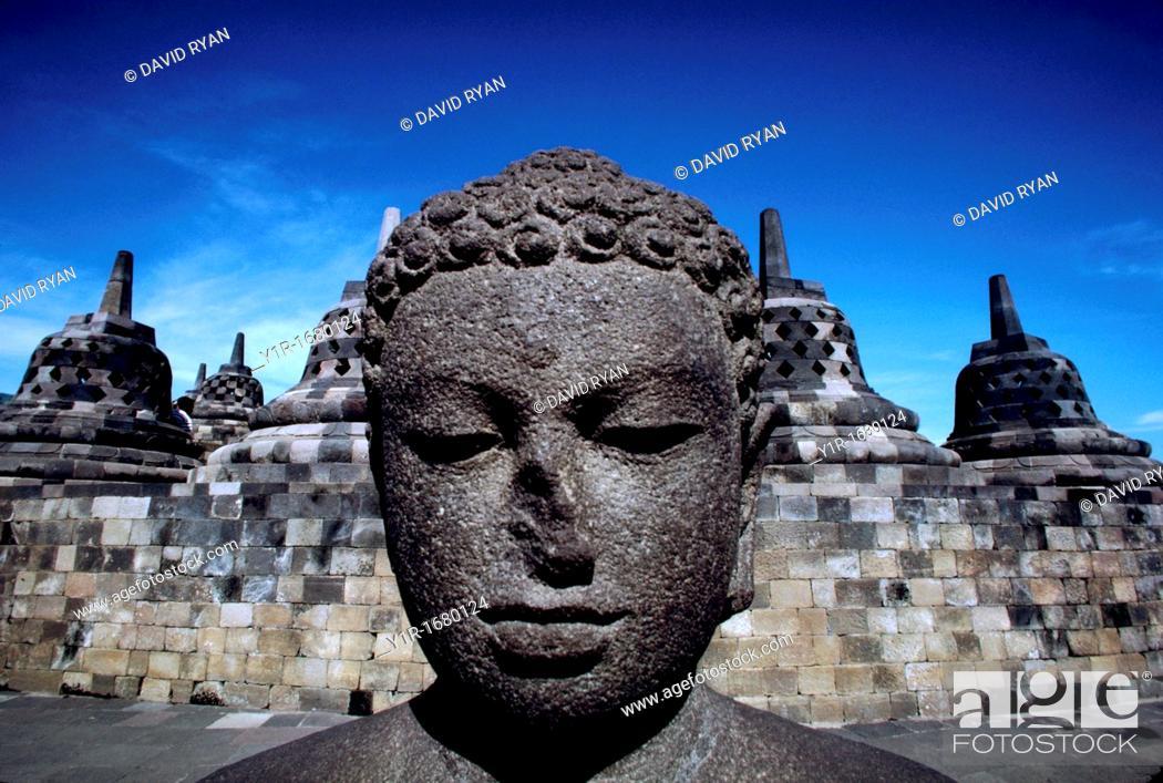 Stock Photo: Indonesia, Java, Buddhist Ruins of Borobodur, Dyani Buddha Statue and Stuppas.