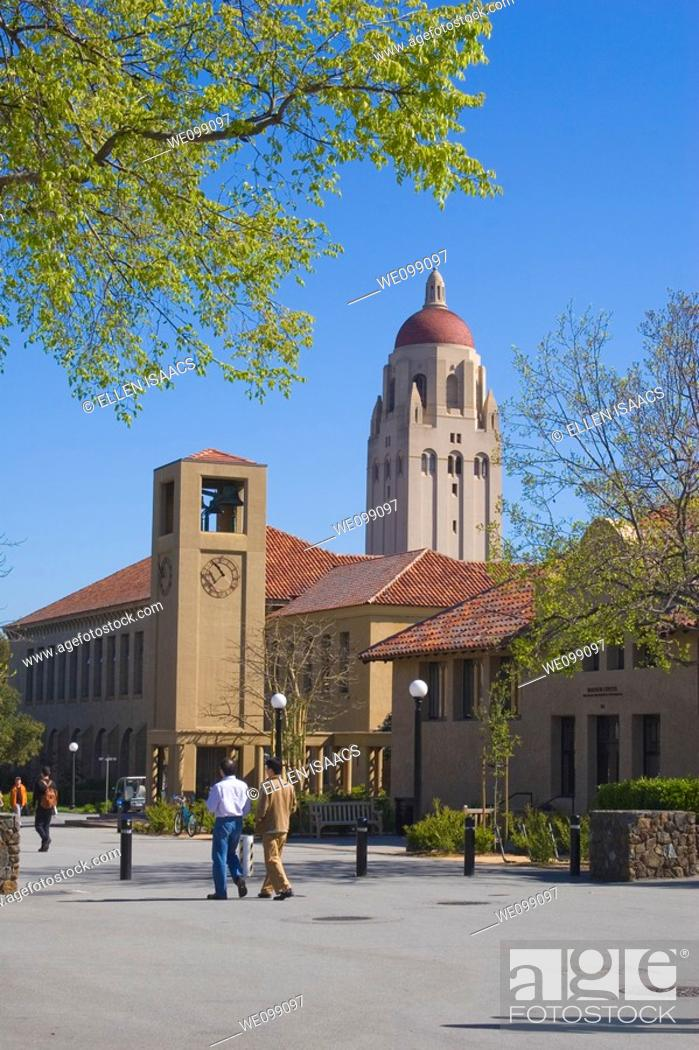 Stock Photo: People walking on a street on the Stanford University campus, with Hoover Tower overlooking the clock tower and at the school of education  The sandstone.
