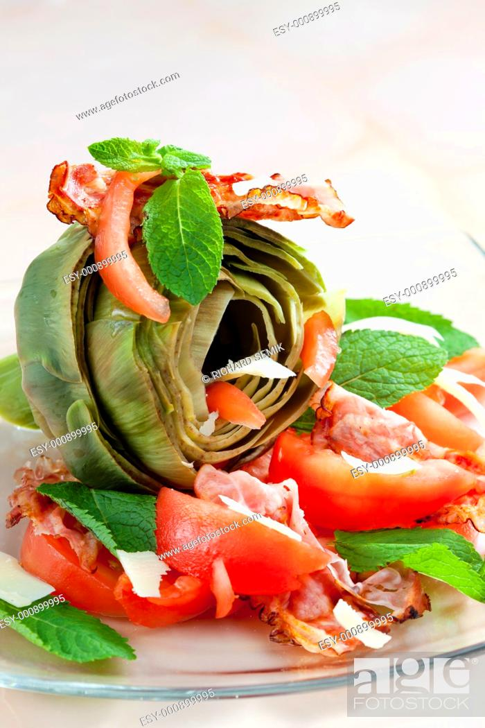 Stock Photo: cooked artichoke with tomatoes, parmesan cheese, pancetta, and mint.