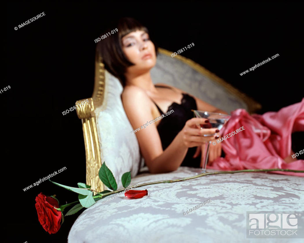 Stock Photo: Woman with cocktail glass and rose.