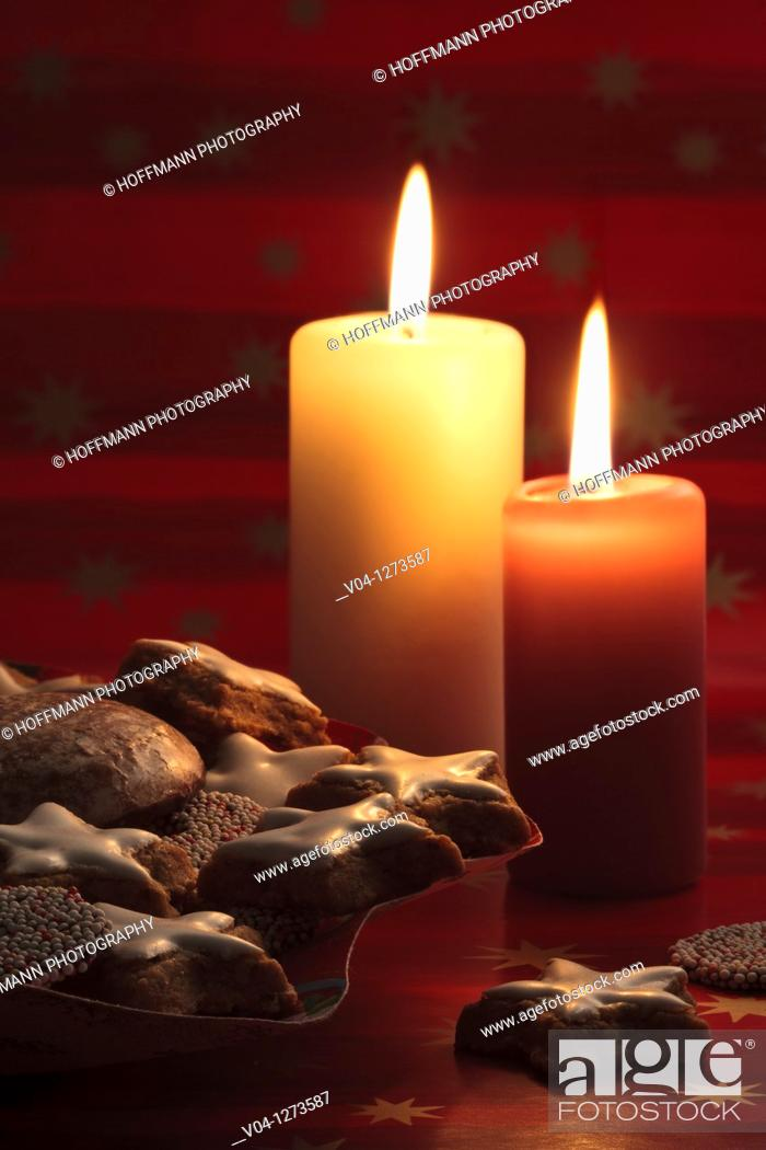 Stock Photo: Lit candles and lots of christmas cookies.
