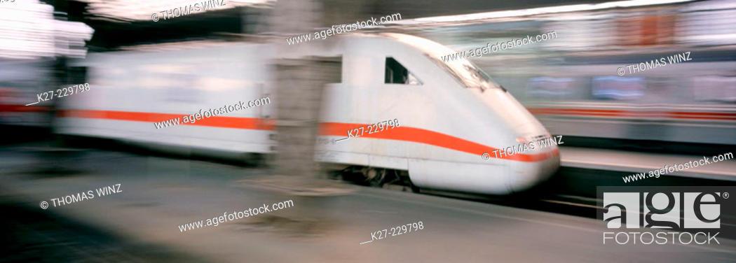 Stock Photo: Intercity Express Train pulling into train station.