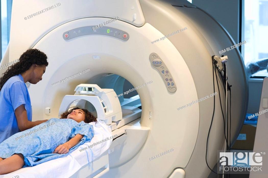 Stock Photo: Doctor preparing patient for MRI.