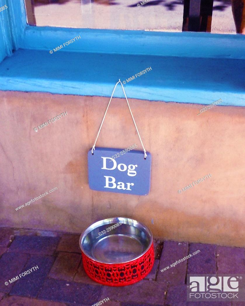 Stock Photo: water bowl on sidewalk for passing dogs on a hot day. Santa Fe, New Mexico.