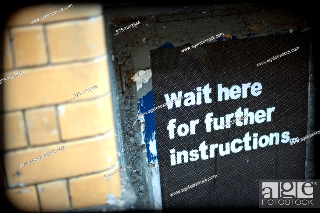 Stock Photo: Â'Wait here for further instructionsÂ' sign. England.