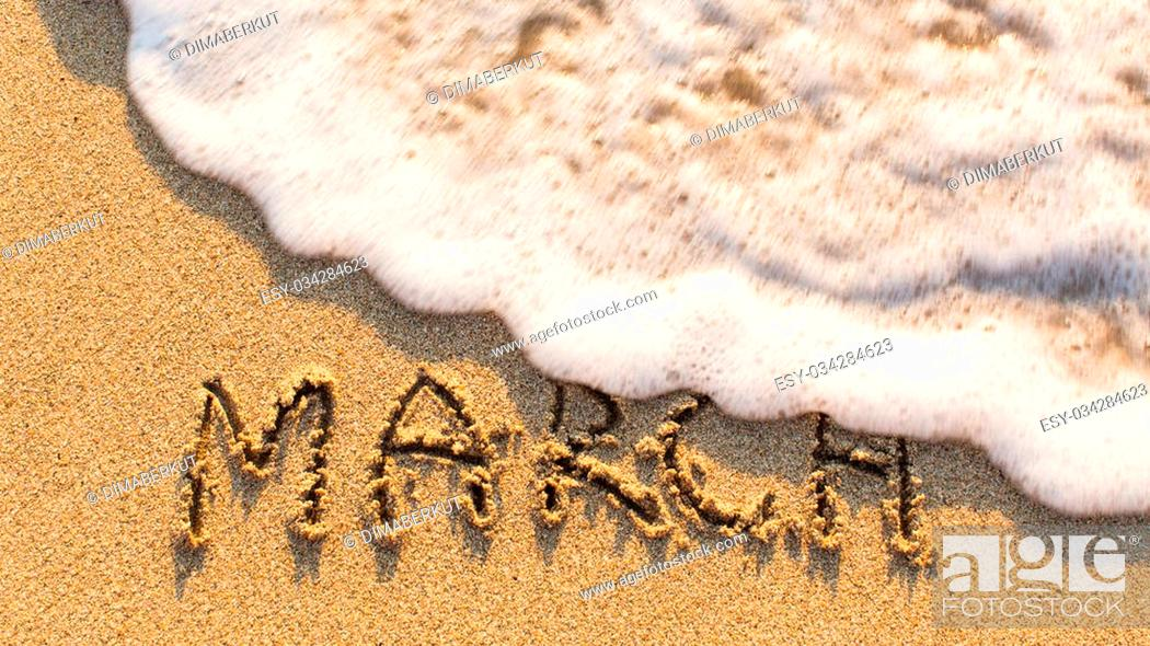 Stock Photo: Inscription MARCH on a gentle beach sand with the soft wave (months of the year series).