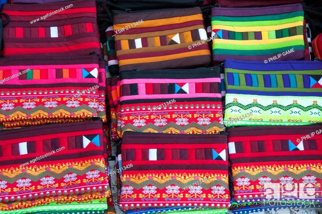Stock Photo: Handmade bags for sale at a night market stall at Mae Hong Son, Thailand.