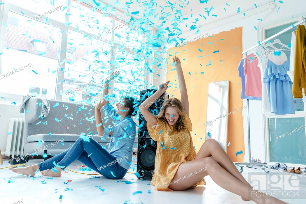 Stock Photo: Two excited young women having a party.