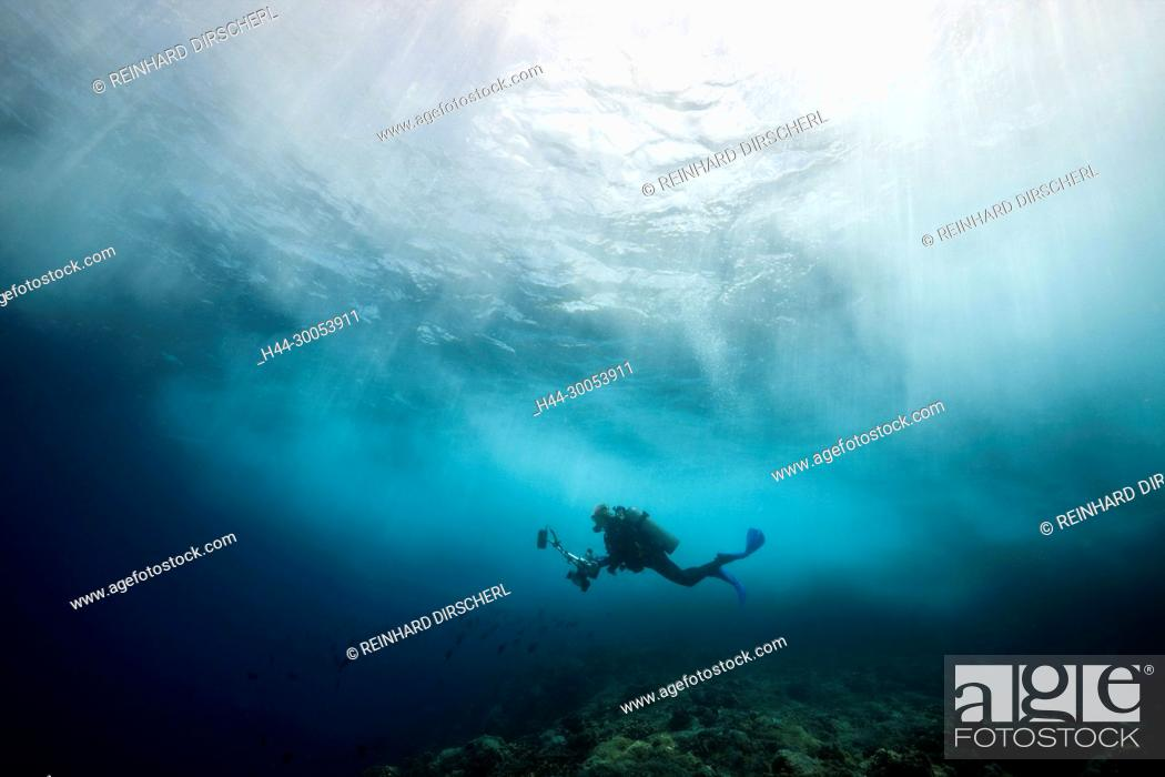 Stock Photo: Scuba diver in surf zone, Christmas Island, Australia.