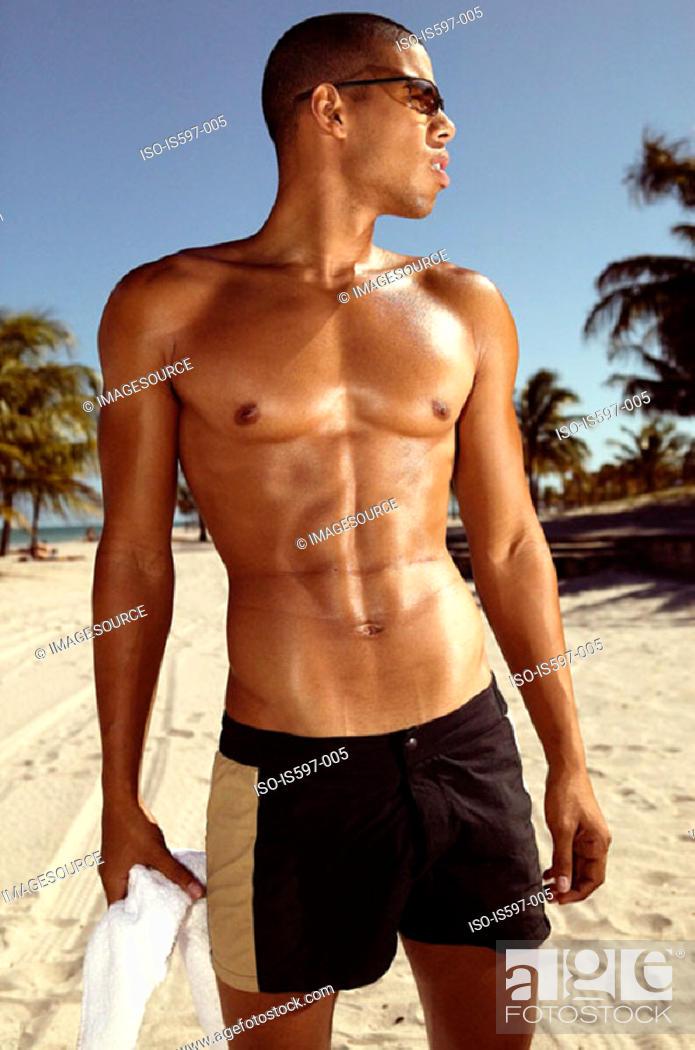Stock Photo: Muscular man on beach.