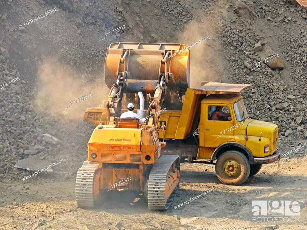 Stock Photo: Bulldozers in rock quarry  Kolkewadi, Ratnagiri, Maharashtra, India.