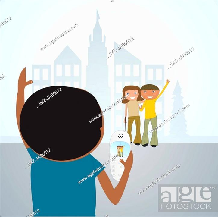 Stock Photo: A boy using a camera phone to take a picture of his parents.