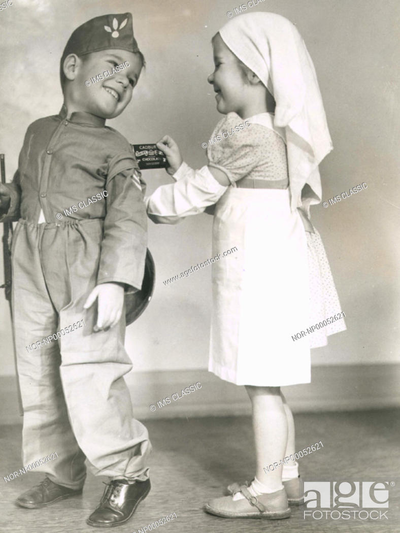 Stock Photo: Two children posing as soldier and nurse.