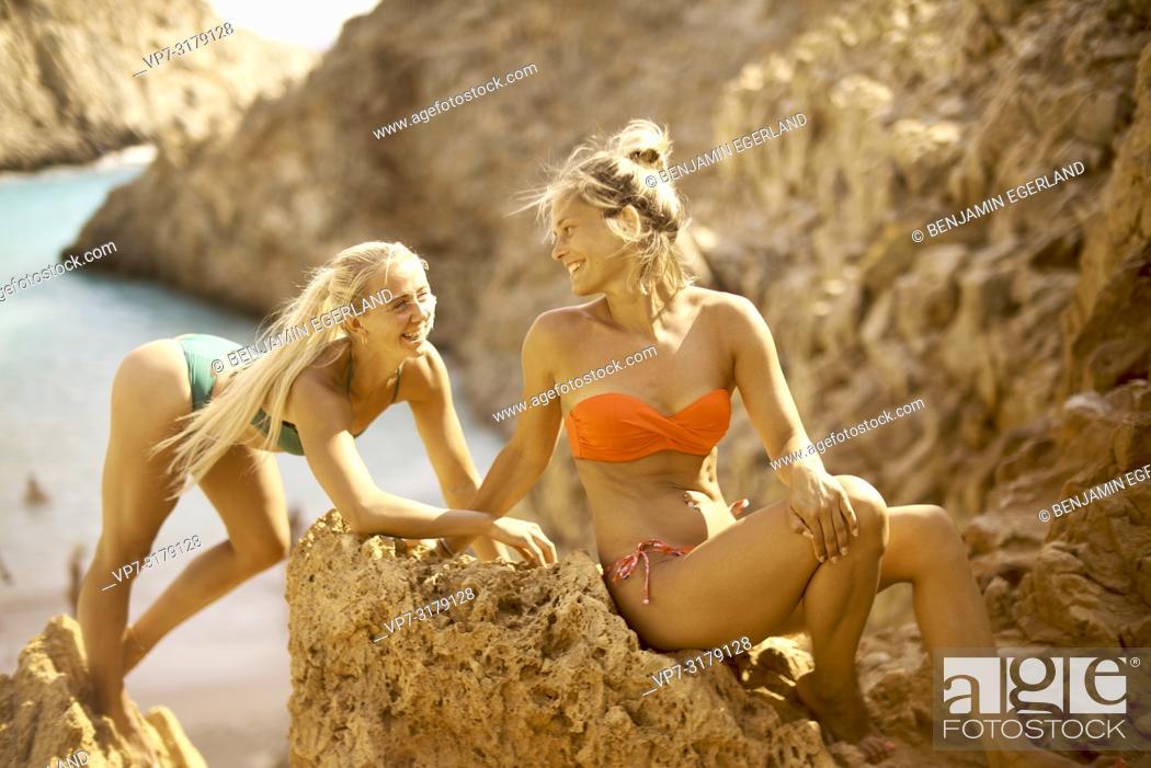 Stock Photo: two women at Seitan Limania Beach, Crete, Greece.
