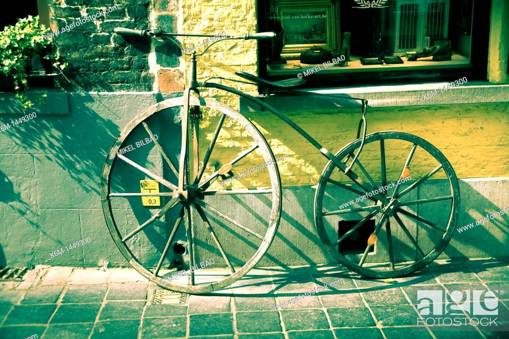 Stock Photo: old wooden bicycle  Bruges, Belgium.