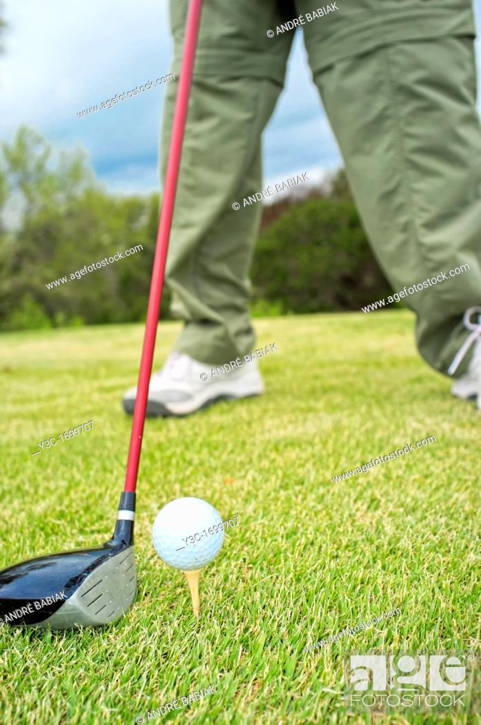Stock Photo: Close up of golf driver and ball on tee.