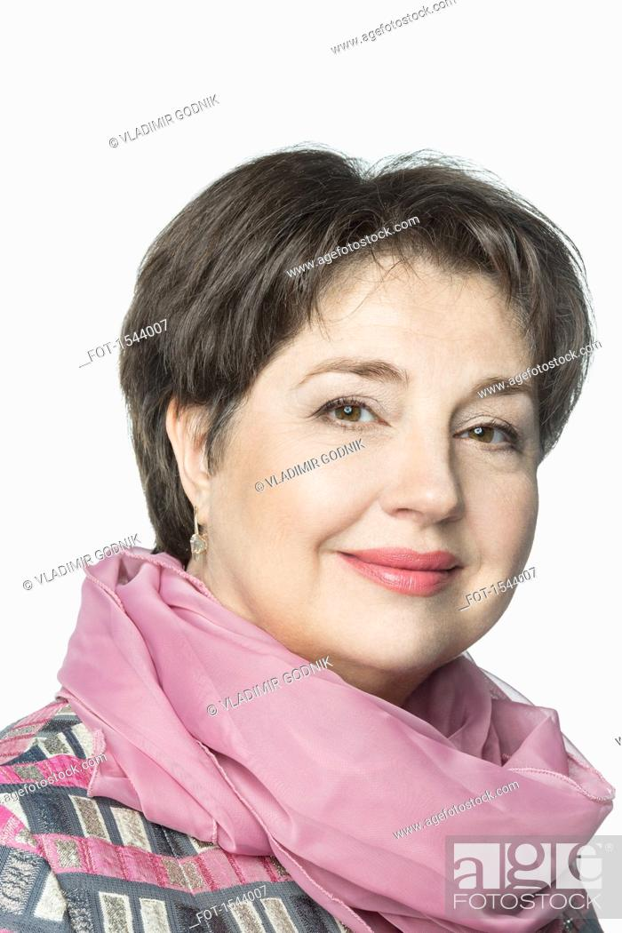 Stock Photo: Close-up portrait of confident mature woman wearing scarf against white background.