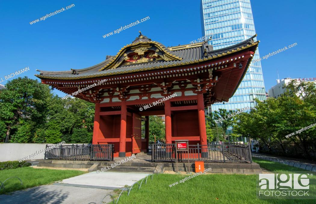 Stock Photo: Tokyo Japan gate of Zojo-ji Temple in Shiba neighborhood in downtown city view red historical monument.