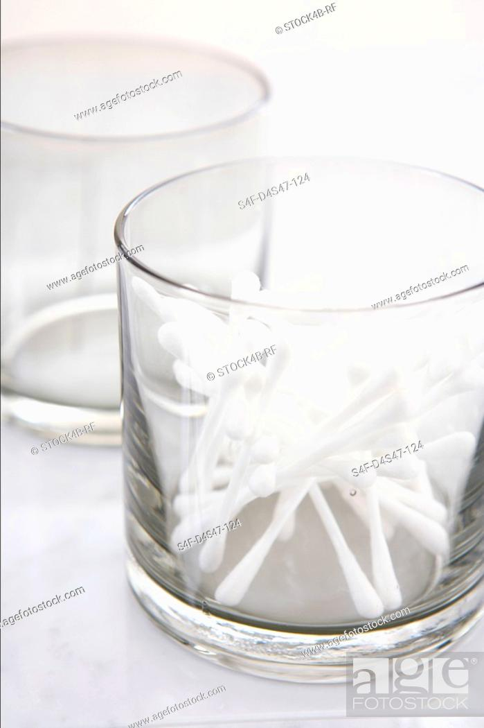 Stock Photo: Cotton buds in a glass.