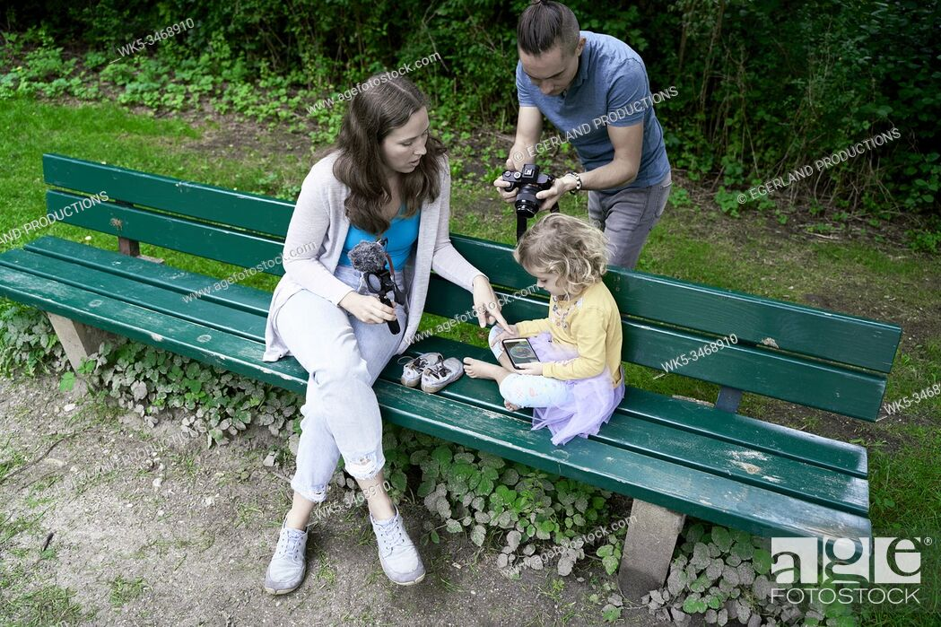 Stock Photo: Family in park, taking photos. Munich, Germany.