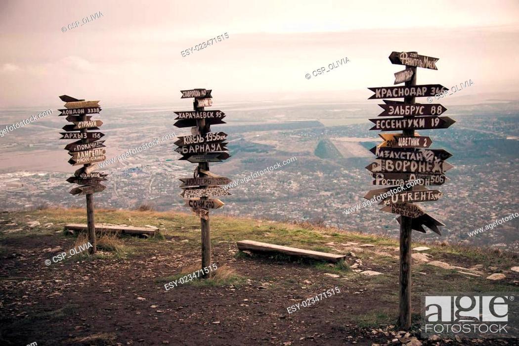 Stock Photo: Pointers distances at mountain top.
