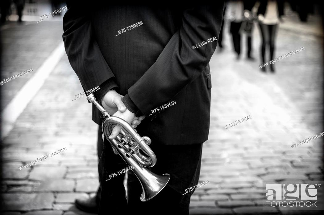 Stock Photo: Musician back with trumpet in hand.