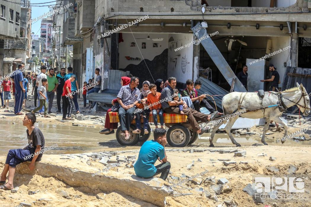 Stock Photo: Palestinians inspect damages to their homes and property, and are trying to salvage whatever items they could. Gaza City.