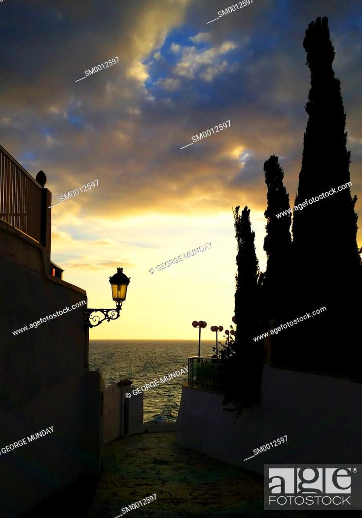 Stock Photo: Small Nerja street leading to the sea, . Costa del Sol, Malaga Province,. Andalucia, Spain.