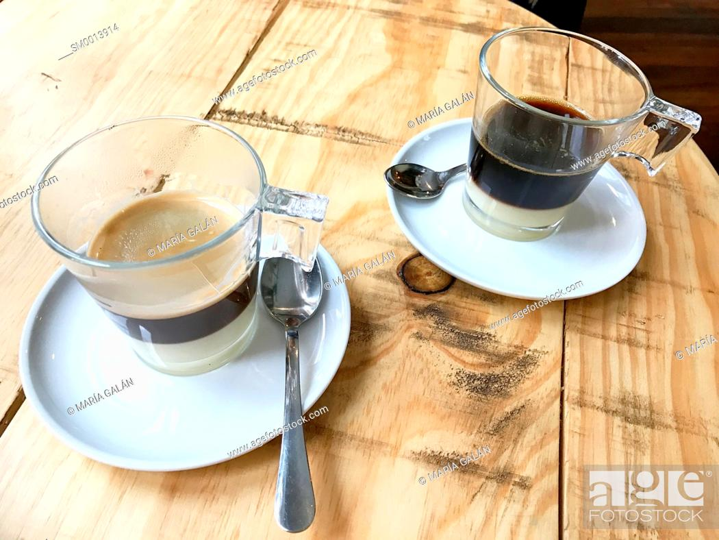 Stock Photo: Two cups of Bombon coffee.