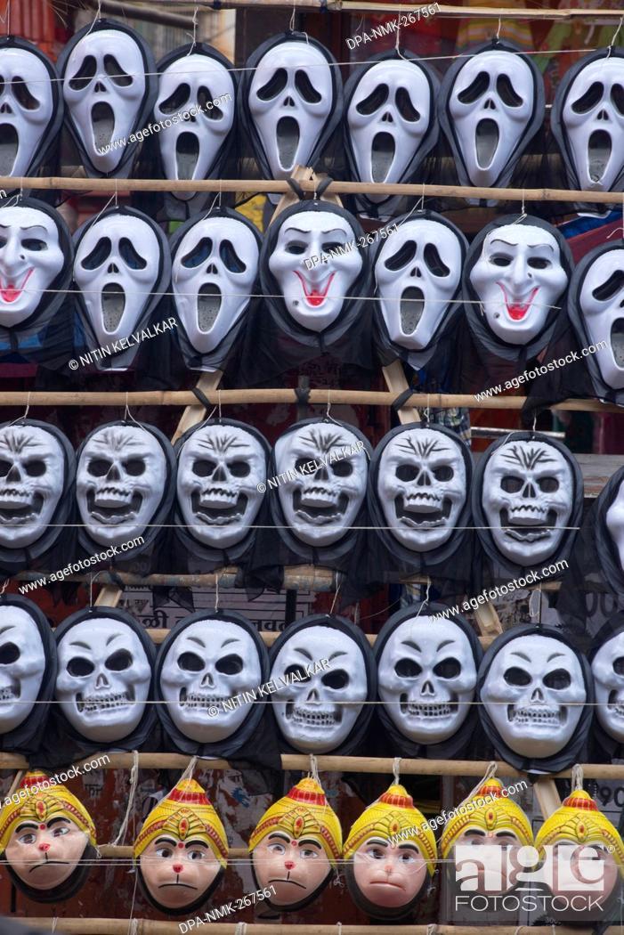 Imagen: Plastic masks of Ghost Scull and Hanuman kept for sell, Pune Maharashtra India Asia.