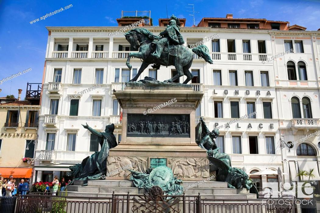 Stock Photo: Low angle view of statues in front of a building, Vittorio Emanuele II Statue, Riva Degli Schiavoni, Venice, Italy.