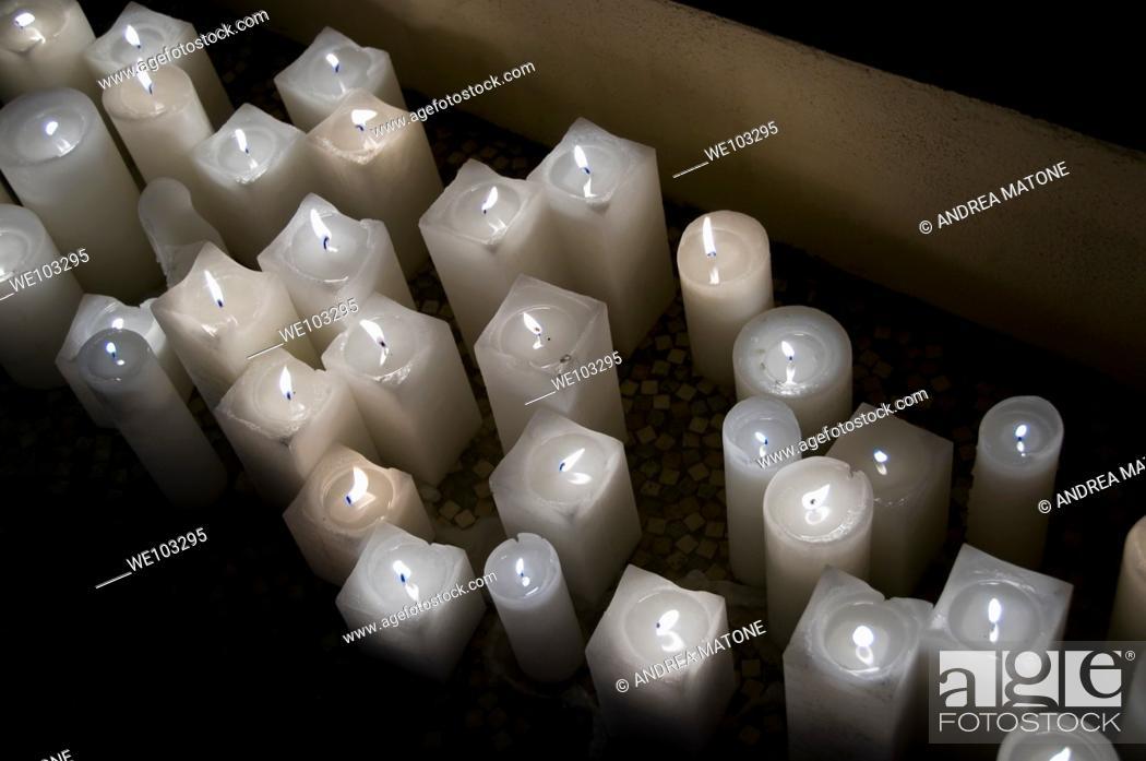 Stock Photo: Lit white candles.
