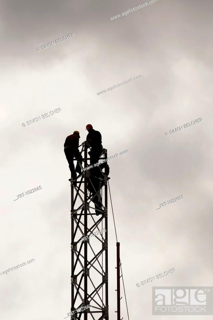 Stock Photo: Engineers Constructing a Communications Tower.