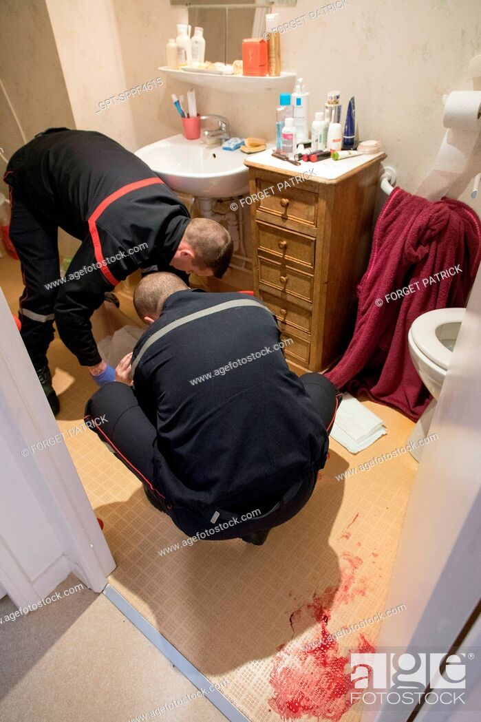 Stock Photo: INTERVENTION FOR A 93-YEAR-OLD CONSCIOUS WOMAN WHO FELL IN HER BATHROOM AND WAS BLOCKED BEHIND THE DOOR, EMERGENCY AND RESCUE SERVICE CENTER OF.
