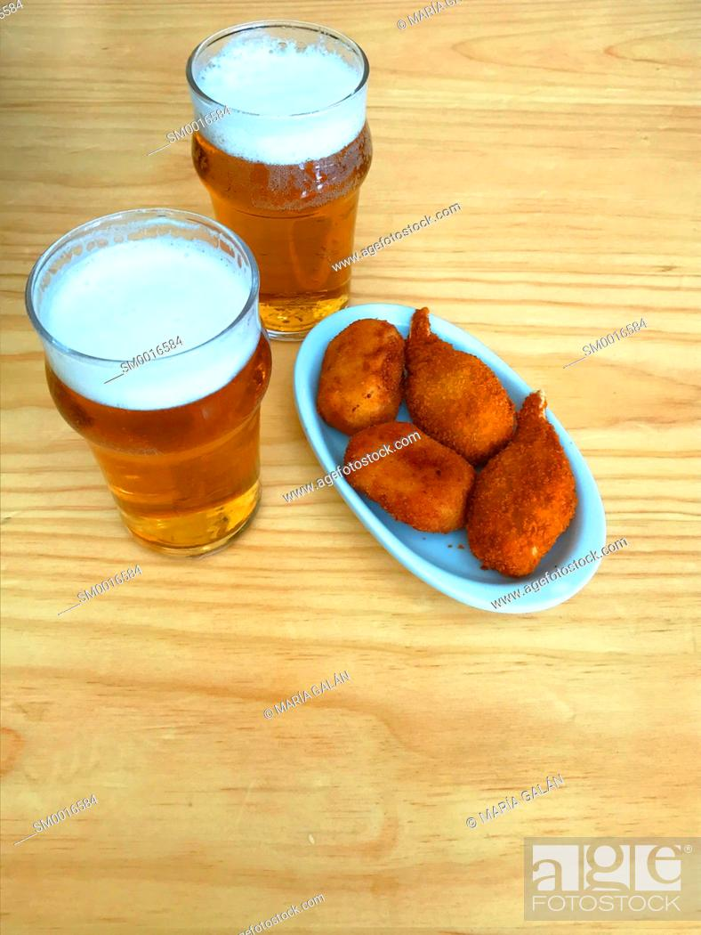 Stock Photo: Two glasses of beer with tapa. Spain.