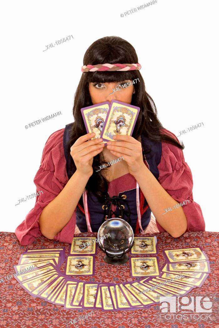 Stock Photo: fortuneteller with crystal ball and tarot cards.