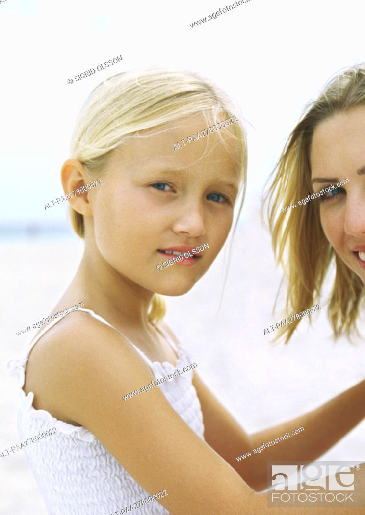 Stock Photo: Girl and mother on beach, portrait.