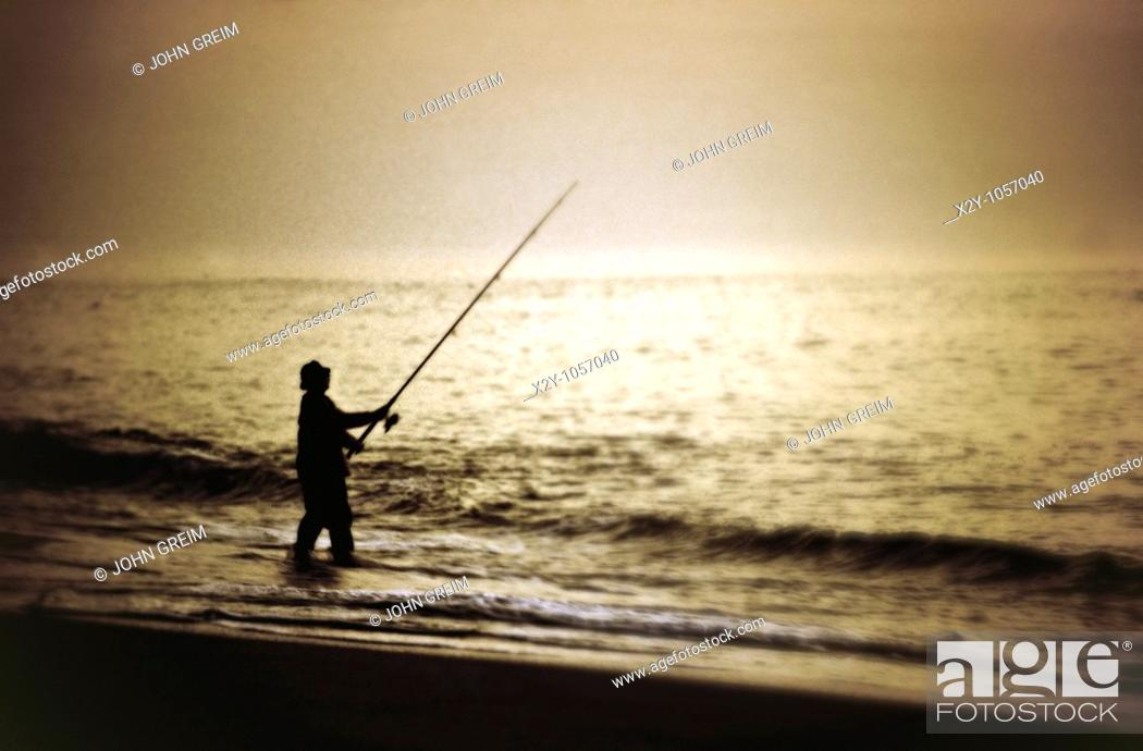 Stock Photo: Man surf fishing, Cape Cod, MA.