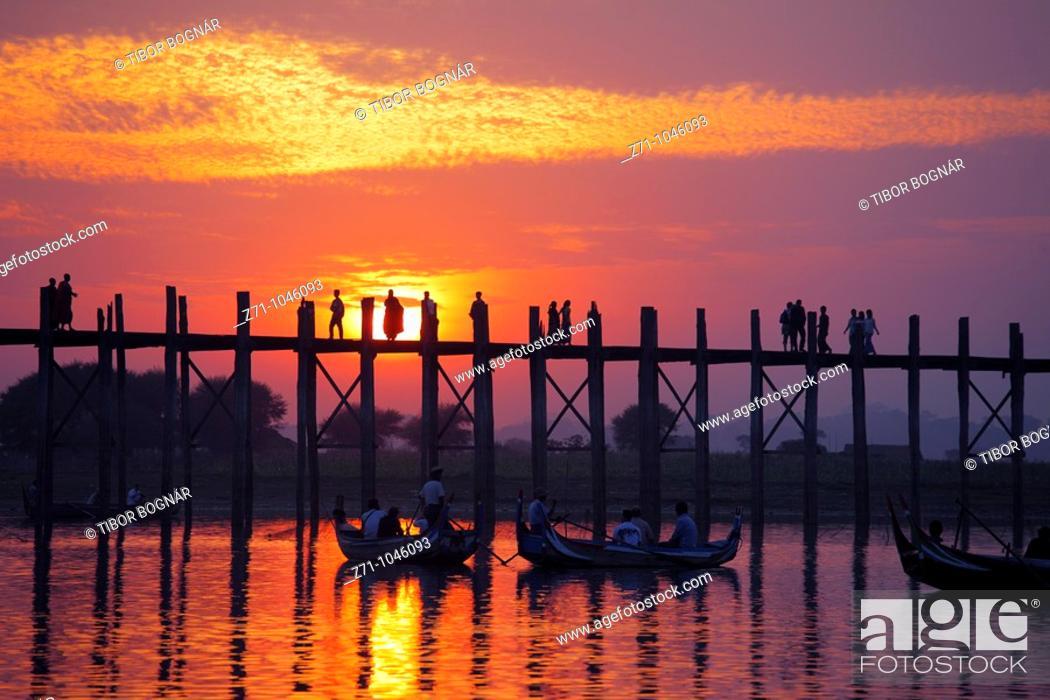 Stock Photo: Myanmar, Burma, Amarapura, U Bein Bridge, Taungthaman Pond, sunset.