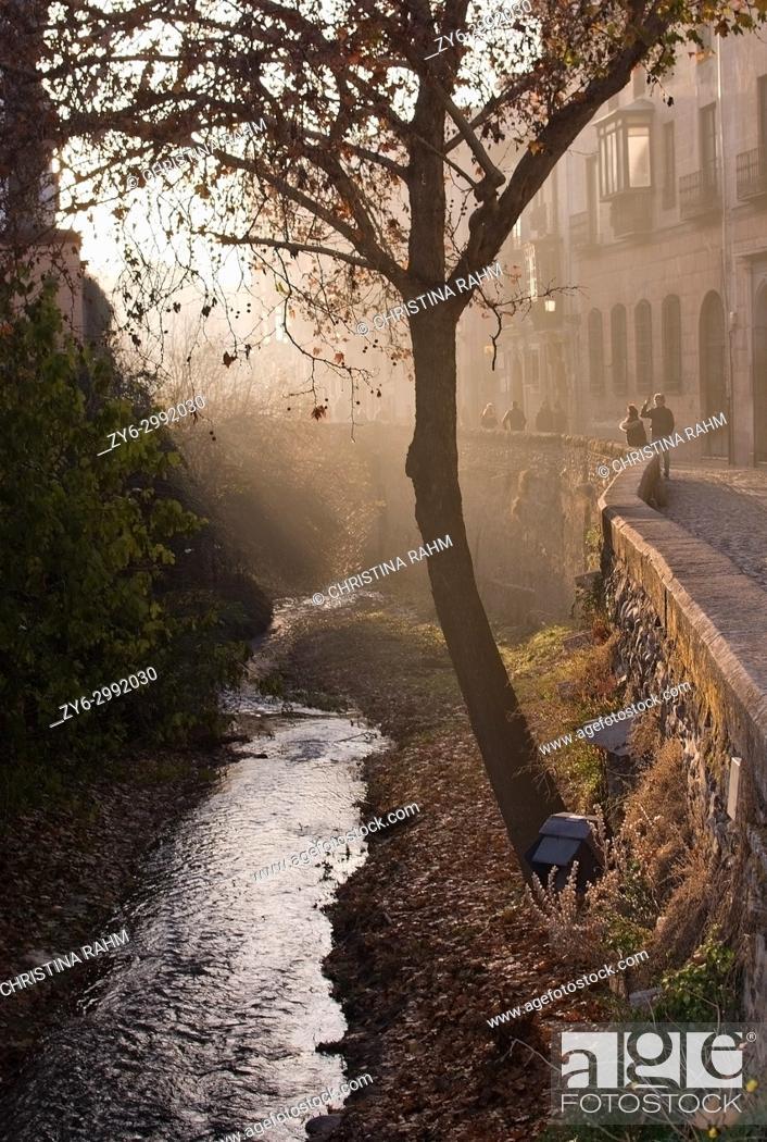 Stock Photo: View along the Carrera del Darro river in afternoon sunhaze in December in Granada, Andalucia, Spain.
