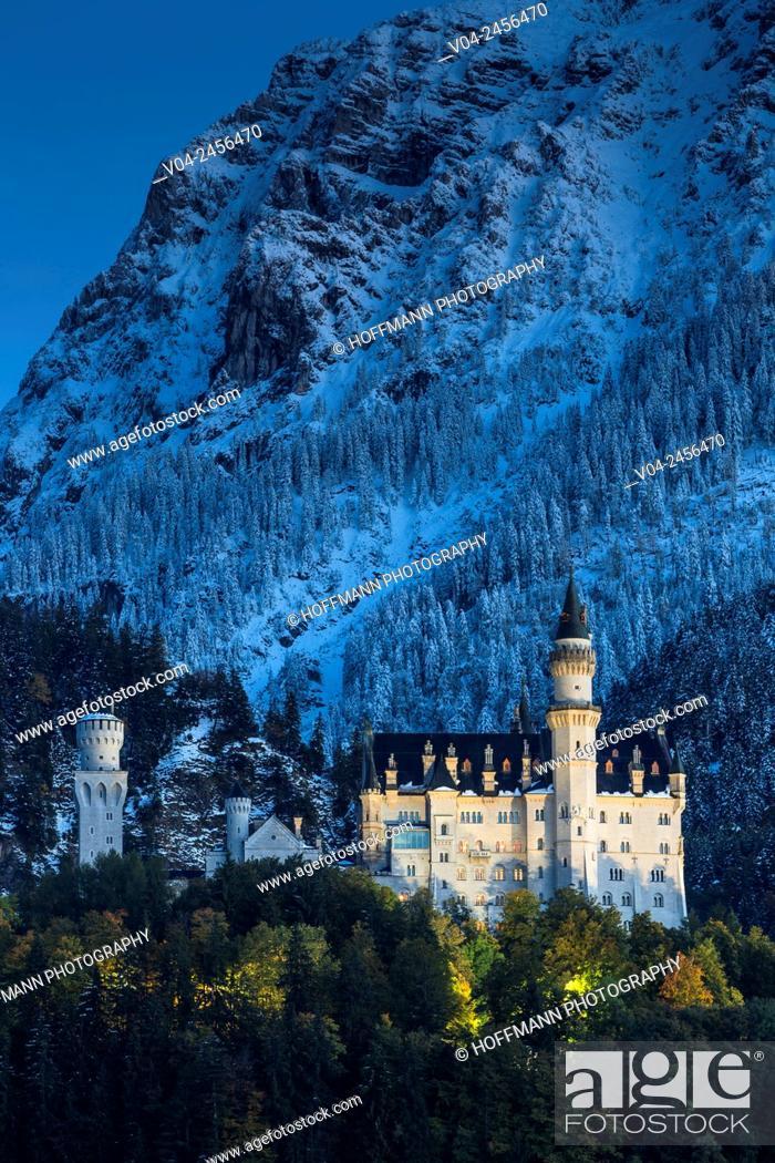 Stock Photo: Famous Neuschwanstein Castle (New Swanstone Castle) at night in winter, Hohenschwangau, Bavaria, Germany, Europe.
